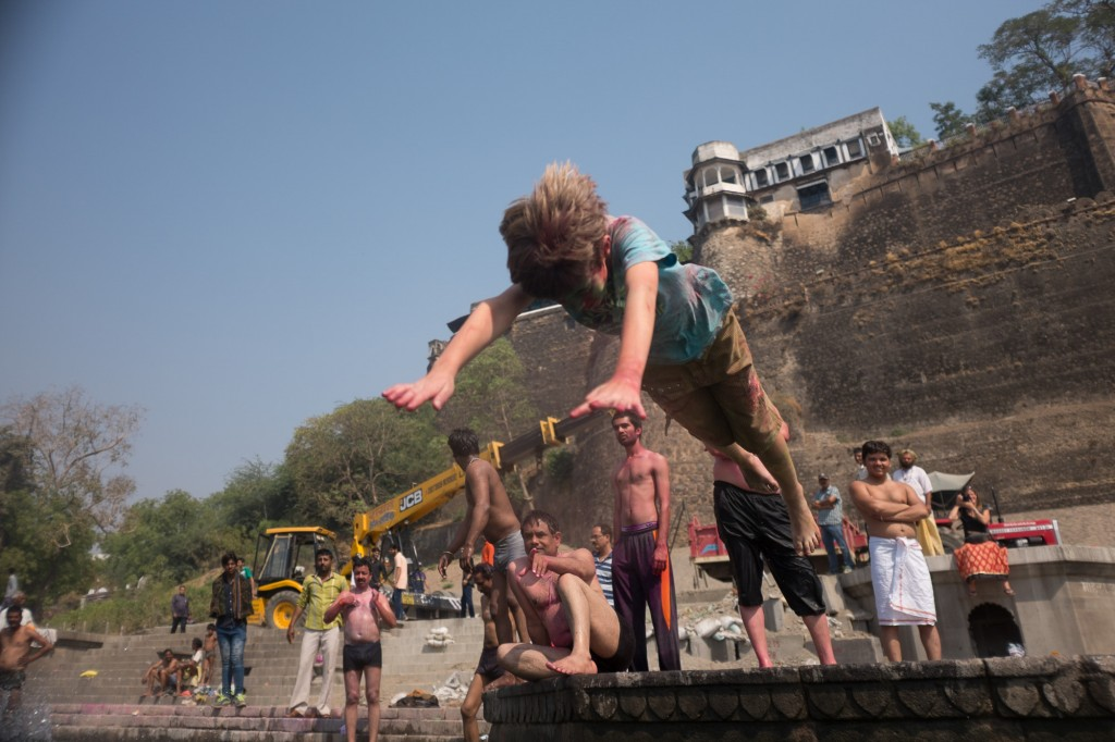 Leaving the Narmada in Maheshwar. One last jump (and best way to clean off the Holi powder).